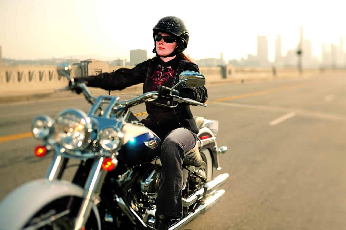 Andrea riding around the city on his motorcycle and with his new helmet.